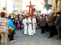 Altar boy walk at the head of the Palm Sunday procession royalty free stock photography