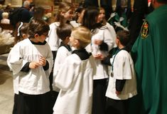 Altar boys inside the church before the start of an easter holy week procession in mallorca. Altar boys and penitents seen before taking part in the procession stock photos
