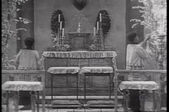 Altar boys lighting candles in church stock footage