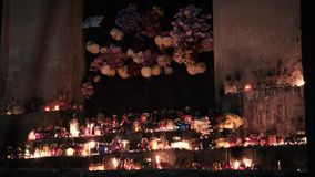 Altar of burning candles in the night of all the saints stock footage