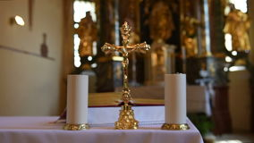 Altar in catholic church with cross and candles from blur to focus. Decorated church interior for wedding ceremony stock footage