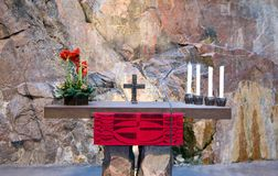 Altar in Catholic church in a rock. Stone, silence, sun, tree Royalty Free Stock Photography