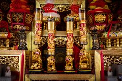 Altar in chinese shrine with wooden sculpture. royalty free stock image