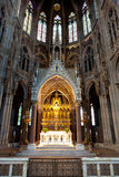 Altar and choir, Votive church, Vienna, Austria. Altar in the choir and stained glass or glass in lead window or the neo-Gothic Votive Church in Vienna, Austria stock photography
