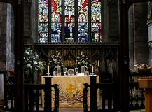 The Altar. Of a church with a stained glass window in the background Royalty Free Stock Image
