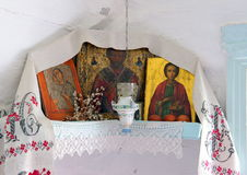 Altar in the corner of Russian country house. Ancient altar with three Christian icons and willow in the corner of Russian country house Royalty Free Stock Photography