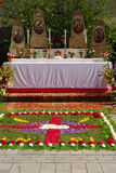 Altar covered with flowers for Corpus Christi services in Neuötting,Germany. An altar decorated with flowers and a floral carpet for Corpus Christi services Stock Photography