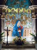 Altar dedicated to the Virgin Mary depicted in a colorful mosaic. Lonigo, Italy - August 8, 2017: Altar dedicated to the Virgin Mary depicted in a colorful Stock Images