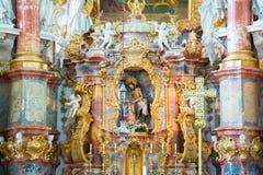 Altar in der Pilgerfahrt-Kirche von Wies Lenkrad und Armaturenbrett Bayern, Deutschland Lizenzfreies Stockfoto