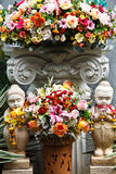 Altar flowers and statues. Stock Photo