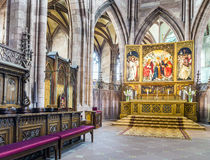Altar in the Freiburg Minster. FREIBURG, GERMANY - JULY 4, 2014: beautiful altar of the minster in Freiburg, Germany. The Altar was created by Hans Baldung Grien Royalty Free Stock Photos