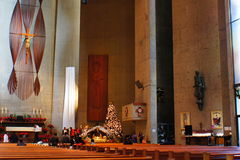 The Altar. The Holy Image of Jesus Christ was the focal point of the Altar inside of St. Barnabas Catholic Church were Catholics going to the mass every sunday Stock Image
