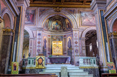 The altar with icons and statues of the island Tiberina in the church of St. Bartholomeo in Rome, capital of Italy Royalty Free Stock Photos