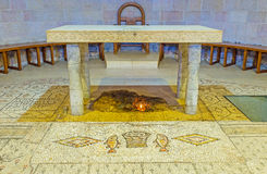 The Altar of Multiplication Church. TABGHA, ISRAEL - FEBRUARY 22, 2016: The stone Altar of the Multiplication Church, with the block of limestone, on which Royalty Free Stock Image