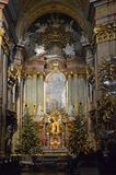 Interior of st peters church vienna. Altar with paitings and christmas trees all around at The Peterskirche English: St. Peter`s Church is a Baroque Roman stock photo