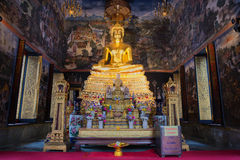 The altar with the sculpture of a seated Buddha in the bot of Wat Wihan Bovornniwet. Bangkok. BANGKOK, THAILAND - JANUARY 06, 2017: The altar with the sculpture Royalty Free Stock Photography