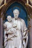 St. Joseph holding baby Jesus Stock Photography
