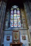 Altar and stained glass in a cathedral in Vienna stock photography