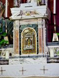Altar tabernacle in marble and baroque and neoclassical decorati. Tabernacle of the marble altar and baroque and neoclassical decorations contains the body of Stock Image