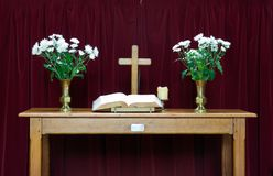 Altar Table. Altar with bible, cross and flowers stock photo