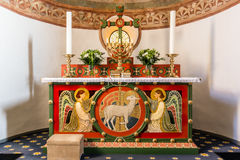 Altar with two angels and the Lamb of God. On the altar is a seven-branched candlestick, Tveje Merlose, Denmark - January 23, 2017 Stock Photos