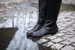 Altas botas de cuero Imagenes de archivo
