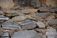 Alte alte Steinwand der mittelalterlichen Festungsnahaufnahme als Hintergrund Lizenzfreies Stockfoto