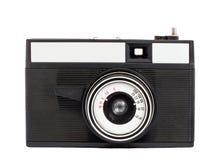 Alte analoge Kamera auf Format des Filmes 35mm lokalisiert auf einem weißen Hintergrund stockbild