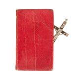 Alte antike Bibel und Kreuz auf einem weißen Hintergrund Stockbild