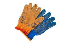 Alte Arbeits-Handschuhe lokalisiert auf Weiß Stockbilder