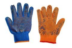 Alte Arbeits-Handschuhe lokalisiert auf Weiß Lizenzfreie Stockfotos