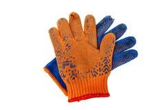 Alte Arbeits-Handschuhe lokalisiert auf Weiß Lizenzfreies Stockbild