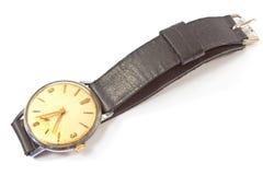 Alte Armbanduhr lokalisiert auf Weiß Stockfotos