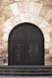 Alte aufwändige Holztüren in Valladolid, Spanien. Lizenzfreies Stockfoto