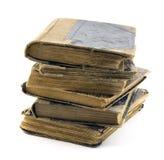 Alte Bücher getrennt auf Weiß Stockfotos