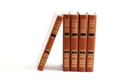 Alte Bücher getrennt auf Weiß Stockfoto
