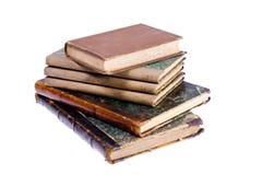 Alte Bücher getrennt auf weißem Hintergrund Stockfoto