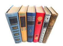 Alte Bücher lokalisiert auf Weiß Stockfoto