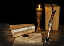 Alte Bücher mit einer Kerze Lizenzfreies Stockbild