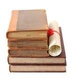 Alte Bücher und Diplom Stockfotografie