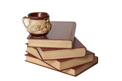 Alte Bücher und ein Cup Lizenzfreie Stockfotos