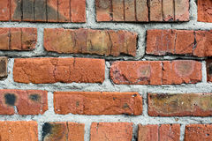 Alte Backsteinmauer der Beschaffenheit Stockfoto