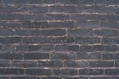 Alte Backsteinmauer der Beschaffenheit bedeckt mit Farbe Stockbild