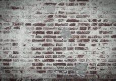 Alte Backsteinmauer des roten und weißen Ziegelsteines, bedeckt mit Gips in s Lizenzfreie Stockfotos