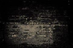 Alte Backsteinmauer, dunkles Licht Stockfotografie