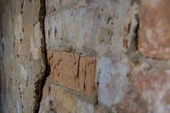 Alte Backsteinmauer in einem Hintergrund Lizenzfreie Stockfotografie