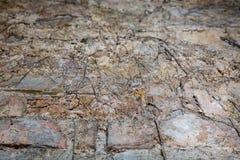 Alte Backsteinmauer in einem Hintergrund Lizenzfreies Stockfoto