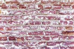 Alte Backsteinmauer in einem Hintergrund Stockbild