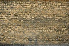 Alte Backsteinmauer für des Hintergrundes, Gelber und Schwarzer Farbe der Beschaffenheit oder Stockbild