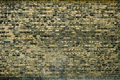 Alte Backsteinmauer für des Hintergrundes, Gelber und Schwarzer Farbe der Beschaffenheit oder Lizenzfreies Stockbild